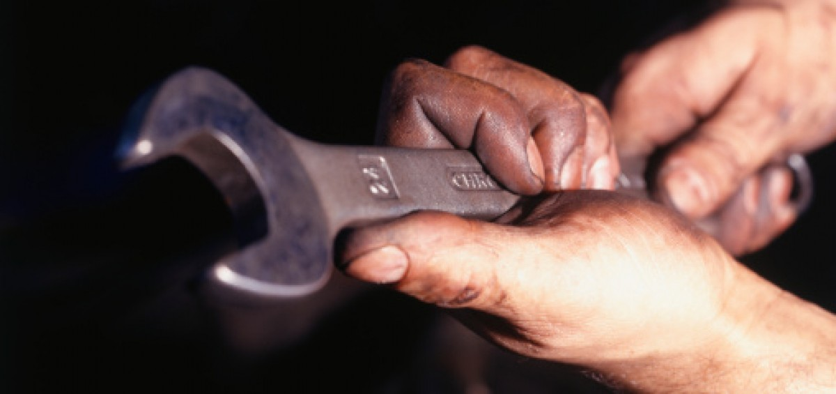 Man holding wrench, Close-up of hands